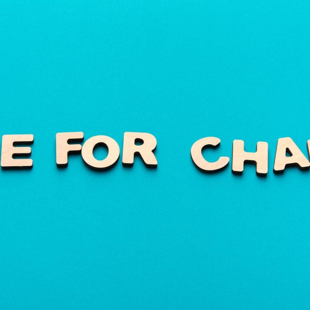 Time for change inscription on blue background
