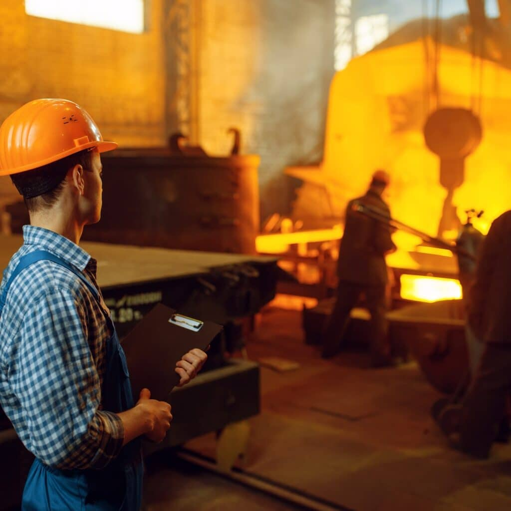 Master looks on steelmaking process in furnace