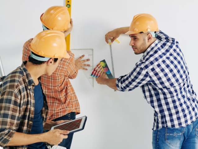 Workers Taking Measurements
